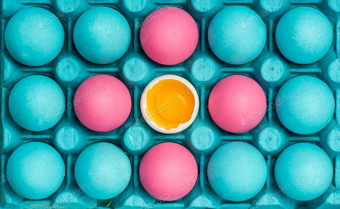 Pastel eggs painted in tray, vibrant design