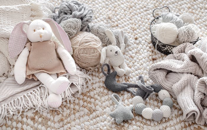 Handmade knitted toys with balls of thread .