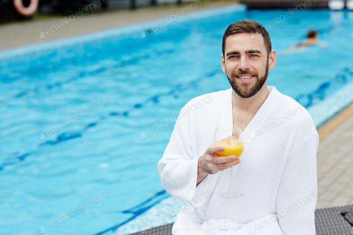 Man by swimming-pool