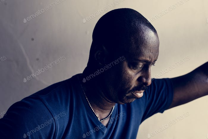 African American man looking down
