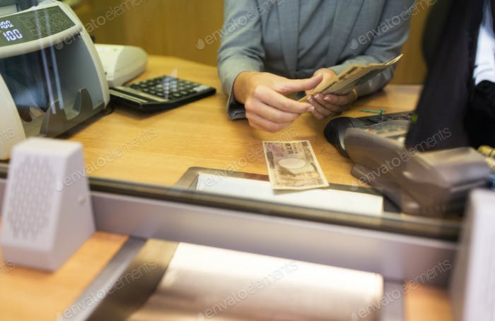 clerk counting cash money at bank office