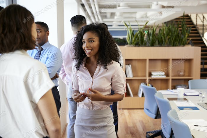 Female Business Colleagues Chatting In Office After Meeting