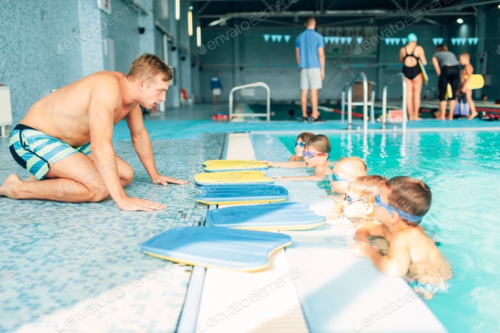 Instructor talking to children in the pool