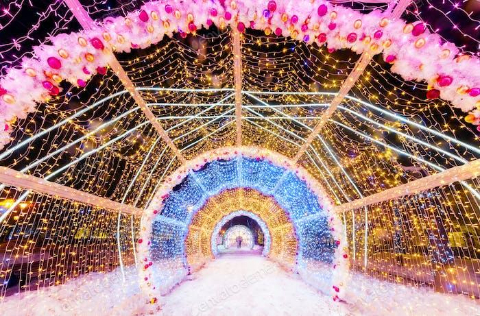 Light tunnel of strings. Christmas