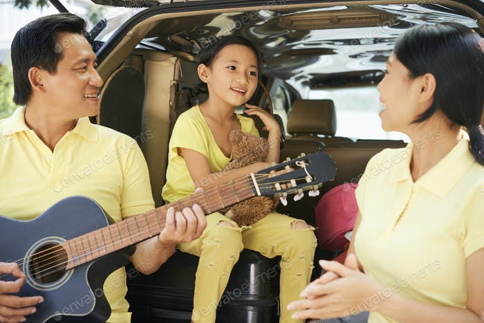 Family singing and playing guitar