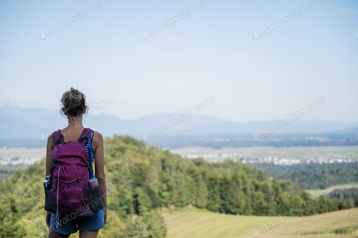View from behind of a female hiker