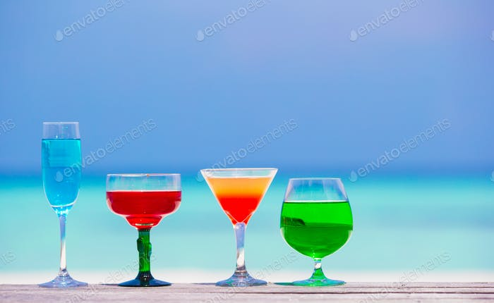 Colorful exotic tasty cocktails background turquoise sea