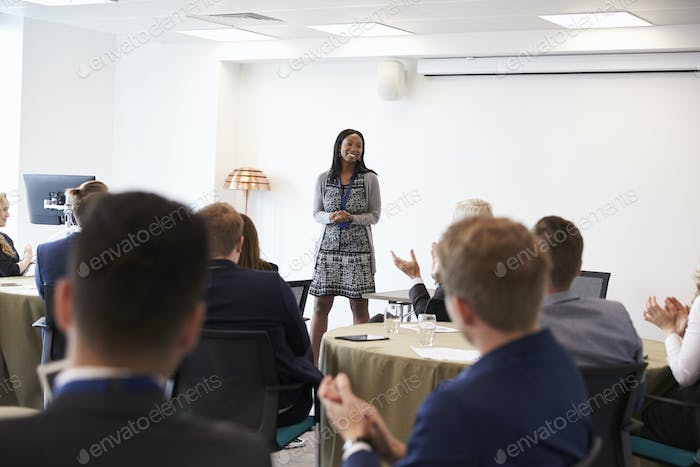 Businesswoman Making Presentation At Conference