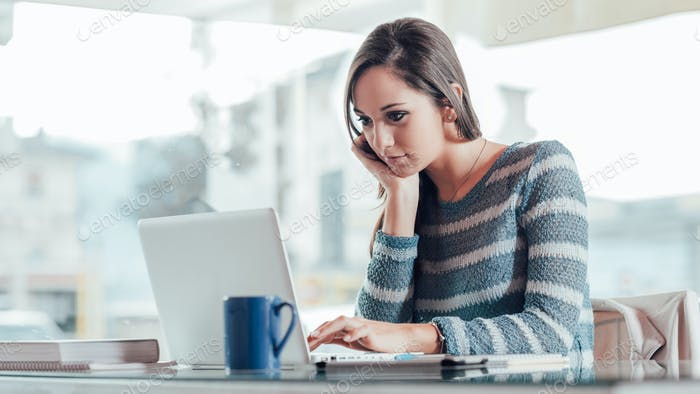 Busy woman working with her laptop