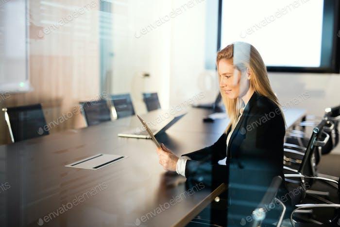 Portrait of beautiful blonde businesswoman holding tablet
