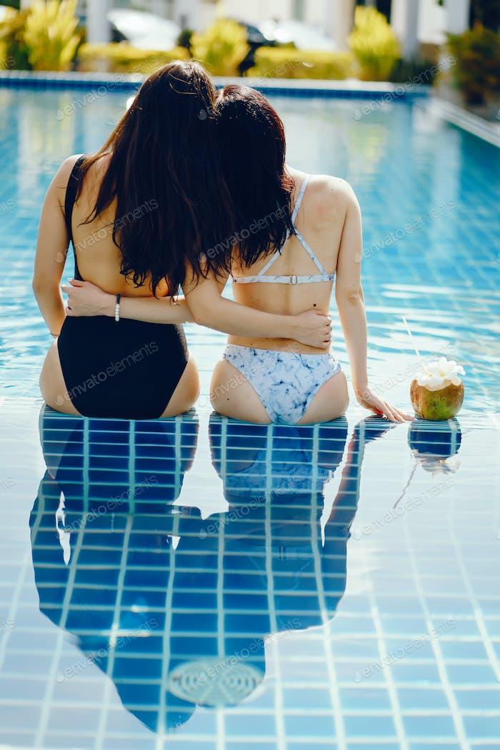 two girls having fun by the pool