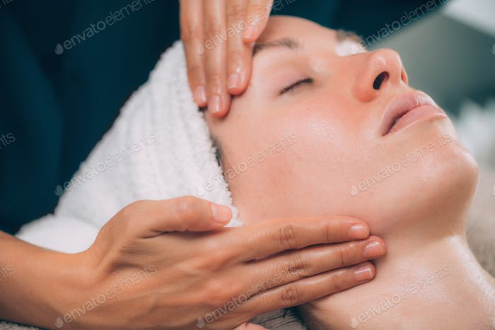 Woman Receiving Facial Fitness Lifting Massage