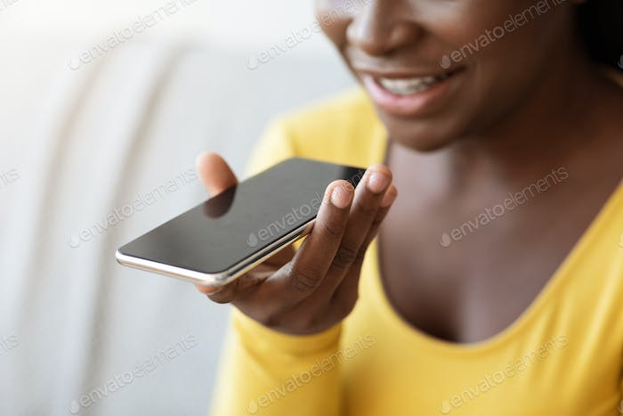 Voice Message. Cheerful Black Lady Using Smartphone Sending Audio Messages At Home