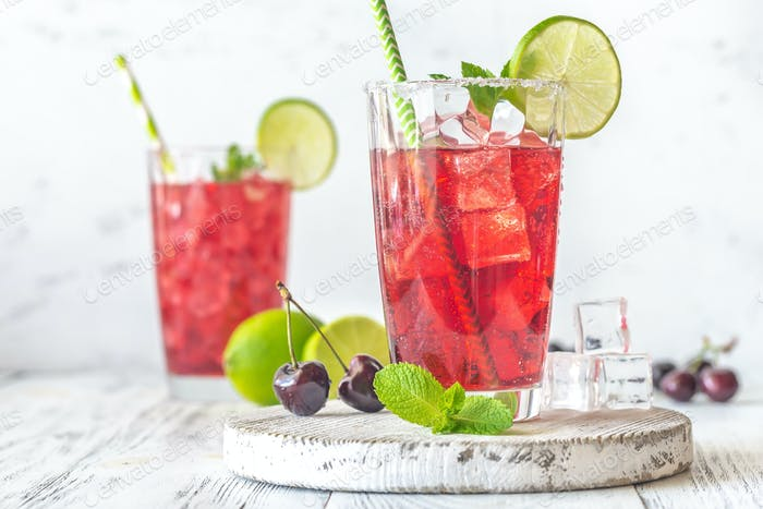 Two glasses of cherry mojito