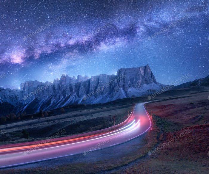 Milky Way over mountain road at night in summer