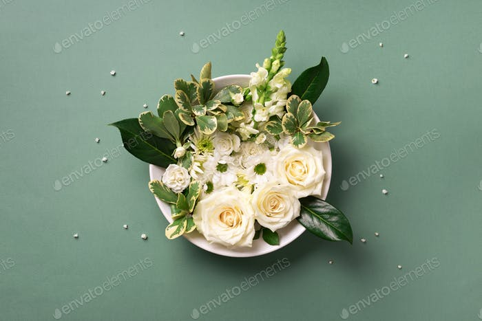 White flowers, roses, lily, gerbera over green background. Valentines day, Woman day concept. Spring