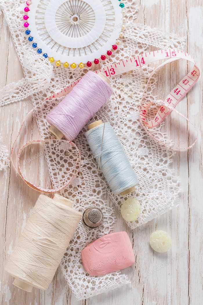 Assortment of sewing accessories on white background. Concept of handcraft.