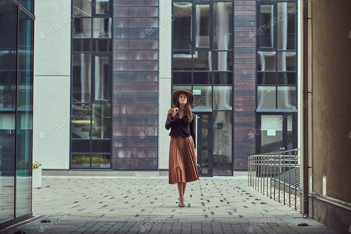 Fashion elegant woman walking on the European city center.