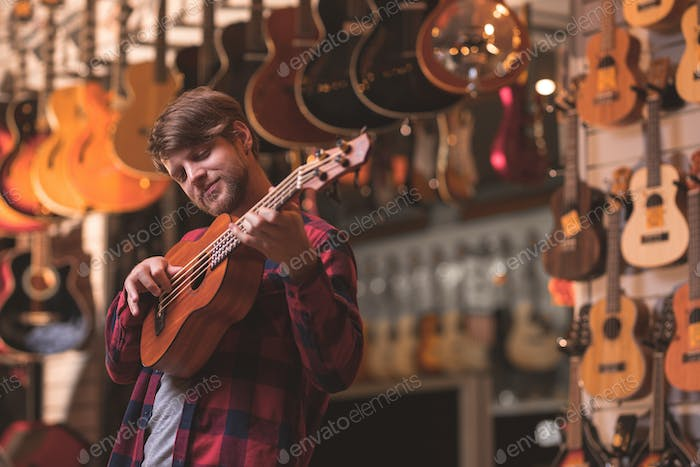 A young musician playing the ukulele