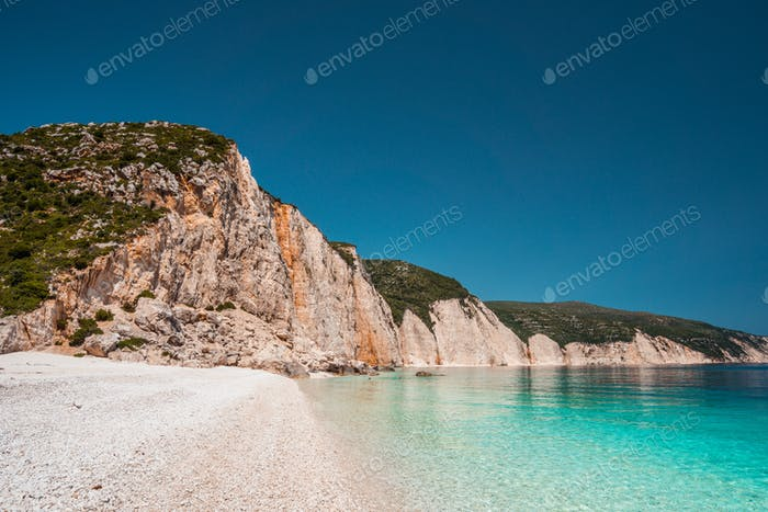 Fteri beach in Kefalonia Island, Greece. One of the most beautiful untouched pebble beach with pure