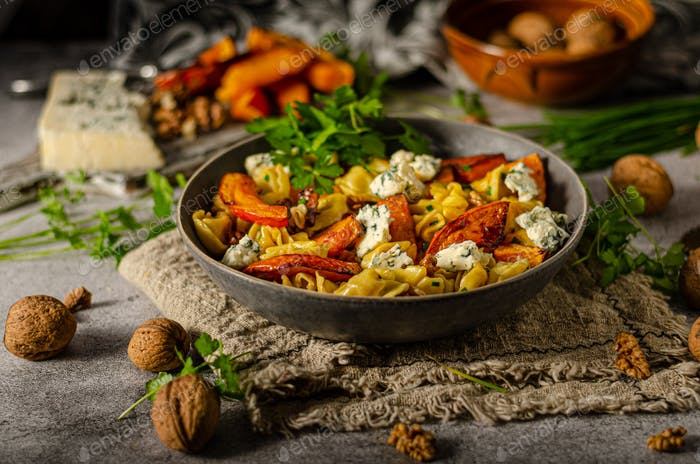 Homemade pasta with roasted pumpkin and blue cheese