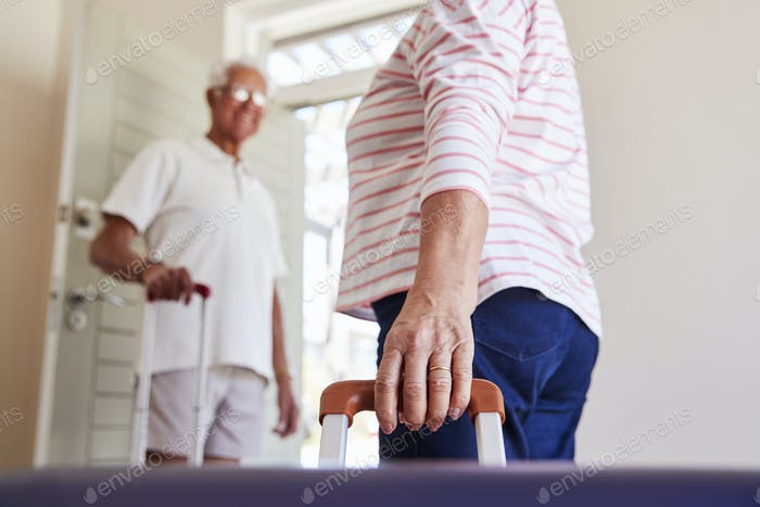 Senior Couple Leaving Summer Vacation Rental