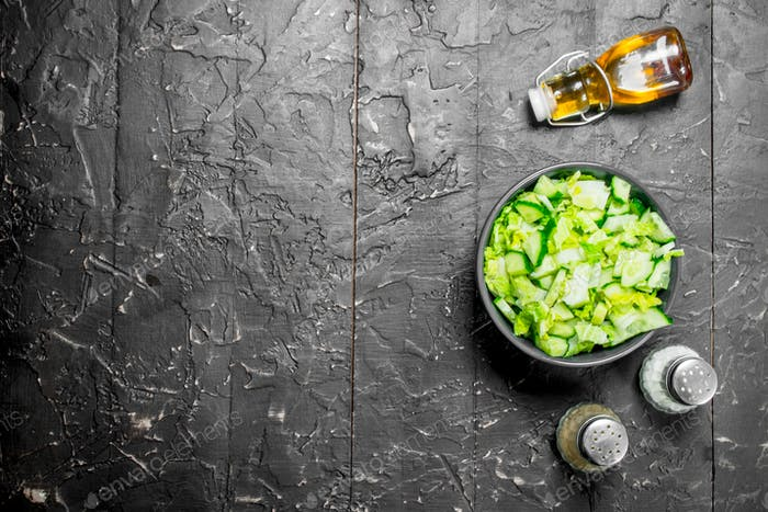 Vegetable salad. Simple salad of cucumbers and Chinese cabbage with olive oil and spices.