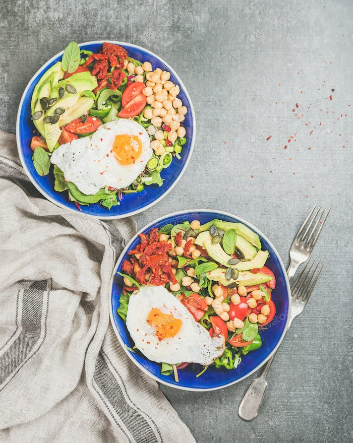 Healthy breakfast concept with fried egg, chickpea sprouts, seeds, greens