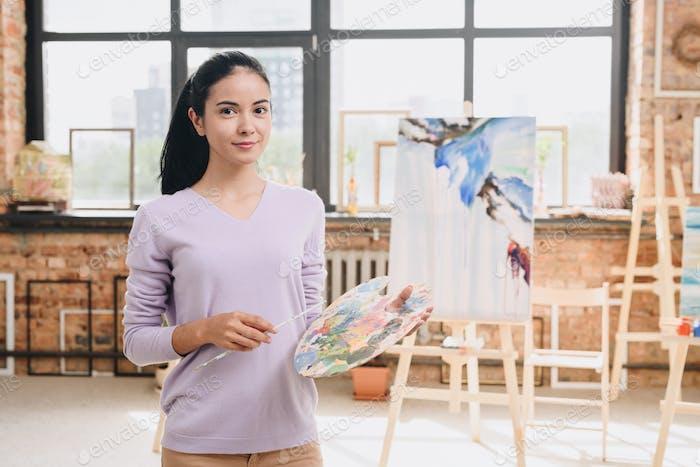 Young Woman Posing in Art Studio