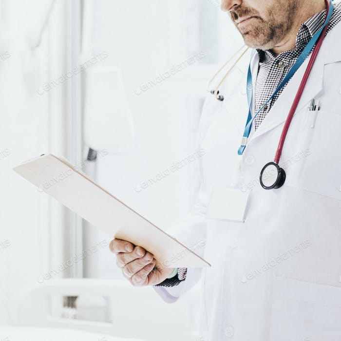 Doctor reading a coronavirus patient medical chart