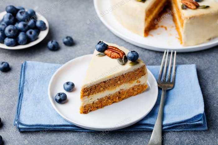 Vegan, Raw Carrot Cake on a White Plate. Healthy Food.