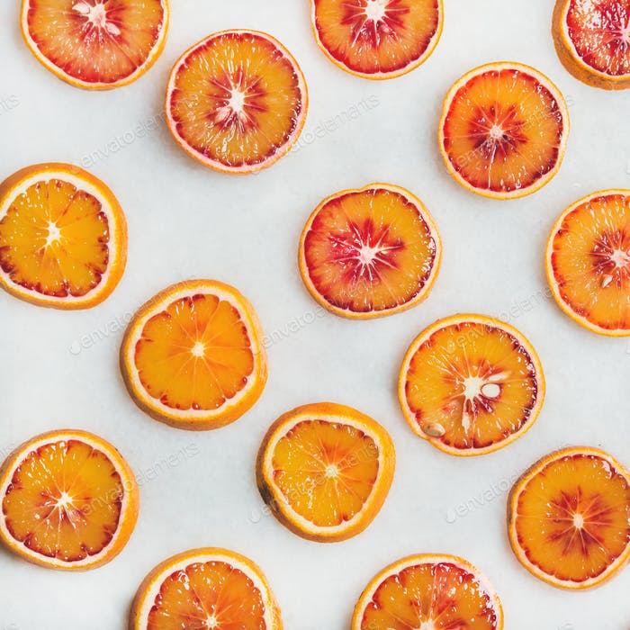 Natural fruit pattern concept with blood orange slices, square crop