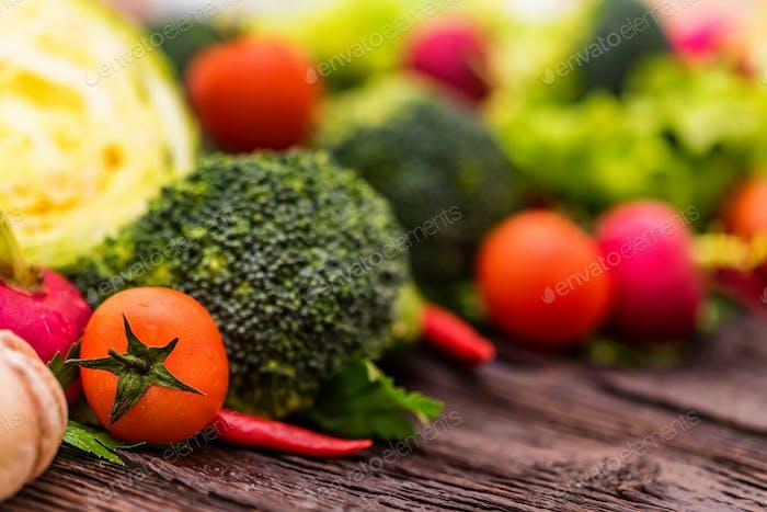 Fresh seasonal vegetables on wooden surface