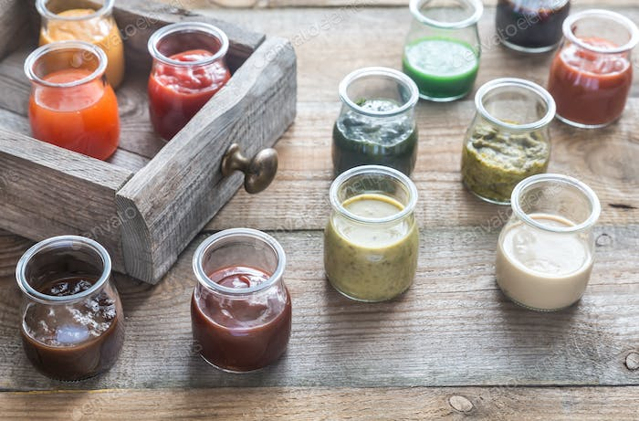 Assortment of sauces in the glass jars