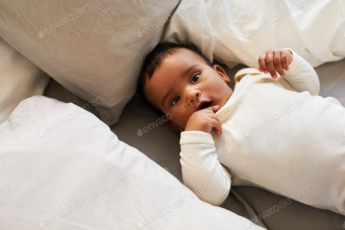 Cute baby in white baby suit