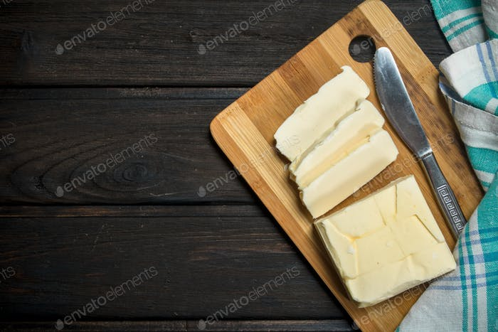 Butter on a wooden Board.