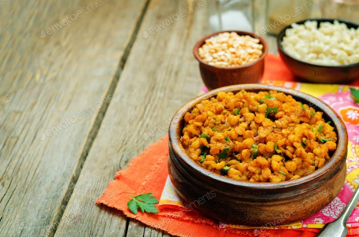 Split peas dal in a bowl on a wood background