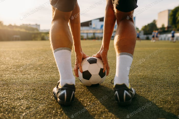 Male football player prepares to hits the ball