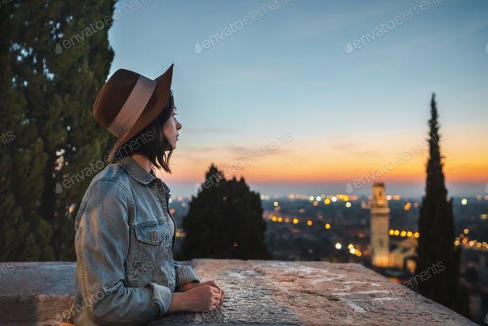 Young woman looking at night view