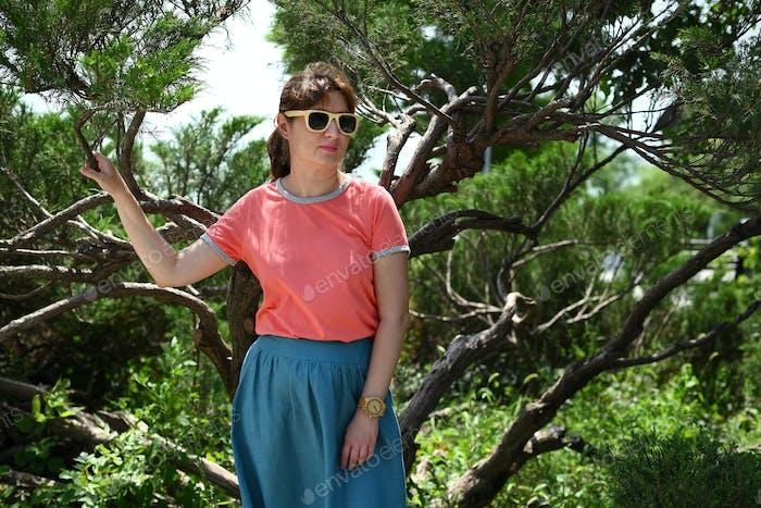Woman in sunglasses near tree