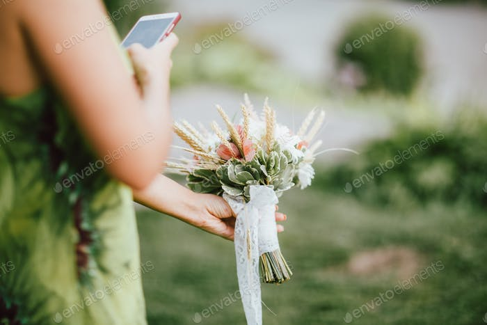 Crop photo of bridesmaid making picture of caught wedding bouquet