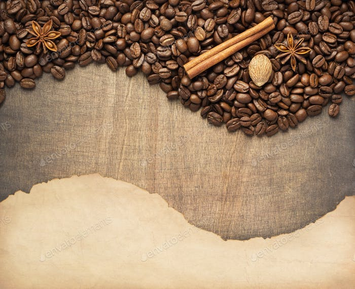 coffee beans and old paper on wood