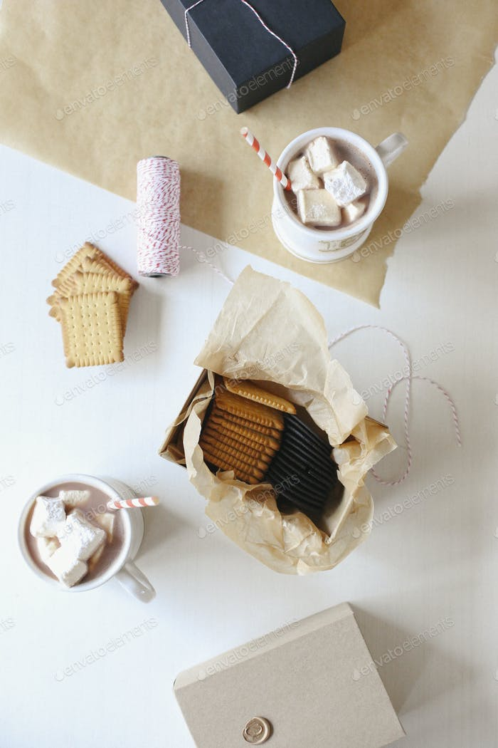 A jar of homemade marshmallows and sweet biscuits.