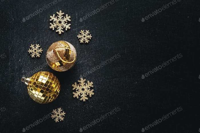 Golden snowflakes with baubles for christmas