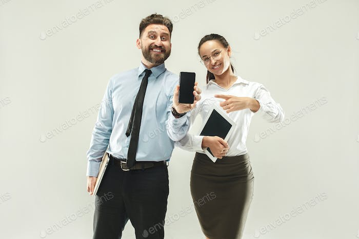 a business man shows the laptop to his colleague in the office.