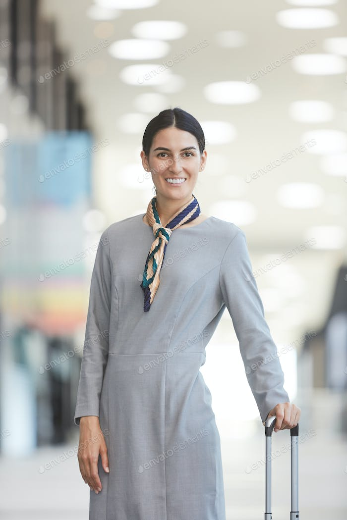 Middle-Eastern Flight Attendant with Suitcase