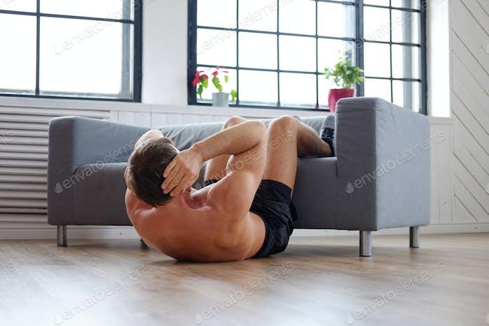 A man doing stomach workouts.