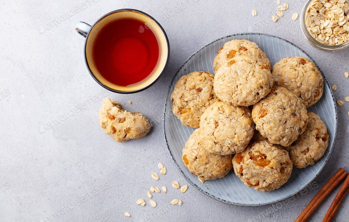 Healthy Vegan Oat Cookies with Cup of Tea. Grey Background. Top view.