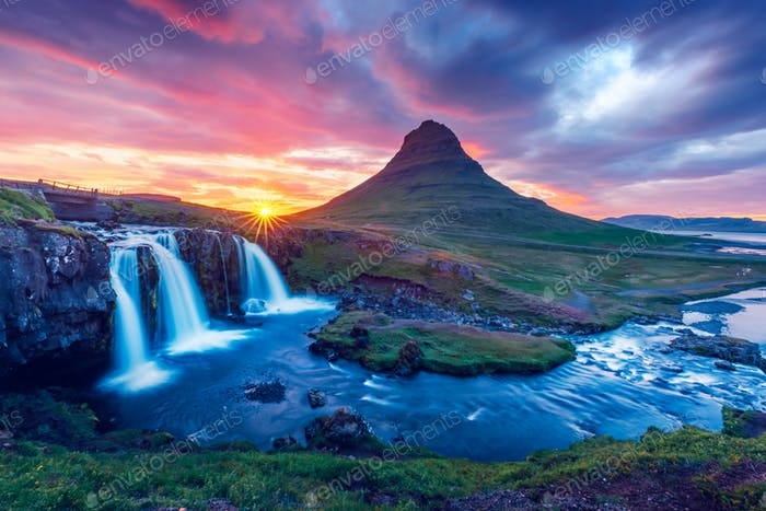 Colorful sunrise on Kirkjufellsfoss waterfall