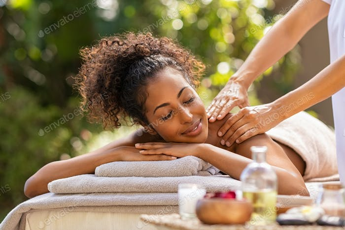 Beautiful woman relaxing with back massage